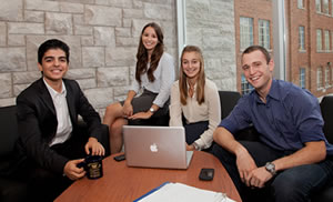 Queen's Commerce students in a Goodes Hall meeting room
